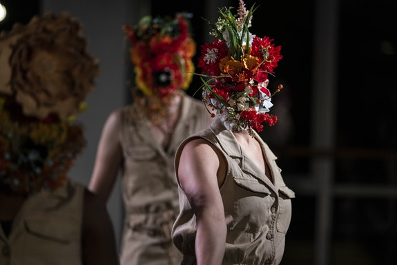 """""""Chorus"""" performers in floral masks designed by Rebecca Makus for Collen Thomas's <em>Light and Desire</em> at New York Live Arts. Photo: Maria Baranova."""