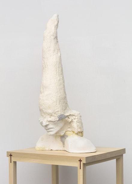 Wardell Milan, <em>Spencer</em>, 2020. Plaster, polyurethane, foam with custom tulip poplar and African padauk pedestal, 37 x 17 x 13 inches. Courtesy the artist and David Nolan Gallery.