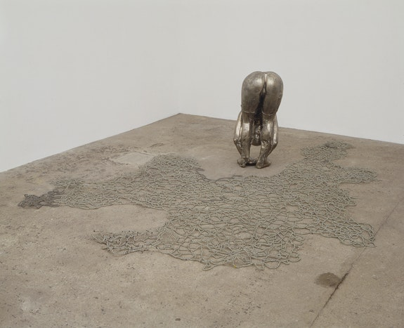 Kiki Smith, <em>Untitled III (Upside-Down Body with Beads)</em>, 1993. White bronze with glass beads and wire, overall installation dimensions variable. © Kiki Smith. Courtesy Pace Gallery.