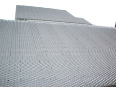 The New Museum's aluminum-mesh cladding. Photo by Benjamin Friedman.