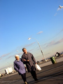 Residents strolling in Coney Island, 2003. Photo by Peter Krebs.
