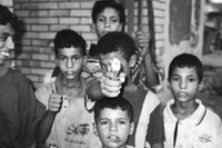 Child with toy gun in Baghdad, August 2003. Photo by Christian Parenti.