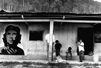 Kids playing at the entrance of the town hall in a Zapatista village of the Lacandon jungle, Chiapas, 1995.