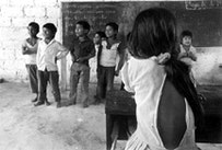 Zapatista children at school from the village of La Realidad. All Zapatista children are obligated when young to go to school. Chiapas.