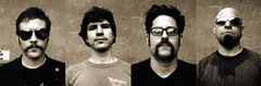 The Giraffes, l-r: Damien Paris- guitar, Andrew Totolos- drums, Aaron Lazar- vocals, John Rosenthal -bass.