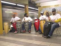 The United Drummers of Yisrael (UDY) performing on the subway platform.