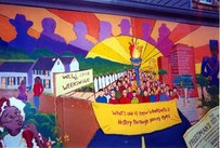 A mural painted by local school kids hangs outside the site of Weeksville. Photos by Kevin Plumberg