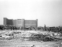 Rubble of looted and bombed Ministry of Water, foreground. Well-protected Ministry of Oil, background. August 5. 2003.