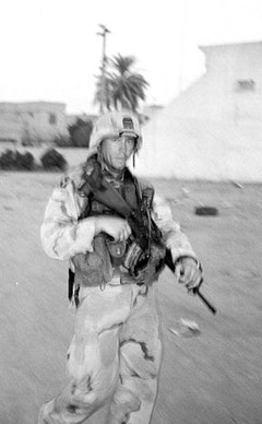 Staff Sergeant Howell, 115ºF and on patrol. August 8, 2003.