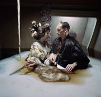Bjork and Matthew Barney gambol in a pool of hot grease.