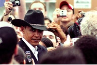 Presidential candidate Barack Obama tips a cowboy hat given to him by a volunteer after a rally in Austin, TX, on Feb. 23, 2008. <i>Photo by Matt Wright</i>