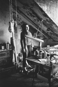 Eva Hesse in her home/studio at 134 Bowery, New York, 1965.  Photographer unknown.  © The Estate of Eva Hesse, courtesy Hauser & Wirth, Zurich, London