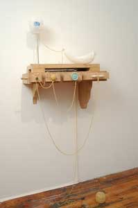 "Marie Sivak, ""Floating Remnants,"" (2007), carved alabaster, marble, selenite, video, string, mdf, pencil, wax, stainless steel, brass."