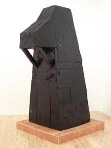 "Whiting Tennis, ""Boogeyman,"" (2007), plywood and hot melt tar. 83 x 44 x 32 in."