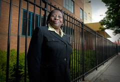 Mary McKinney in front of the Soundview School in the Bronx.