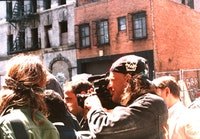 Clayton Patterson capturing a neighborhood demonstration.<i> Photo by Elsa Rensaa</i>