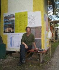 Butler outside her 4' x5' studio shack at Simon Draper's