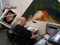 The painter in his studio (in the process of making a portrait of Zhang Huan). Courtesy of Chuck Close studio.