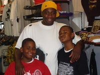 Joshua Brown with his sons inside the B Shop in East New York. Photo by Terésa Stern.