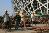 <i>Migrant workers in July 2007 at Beijing's Olympic Stadium, known as the
