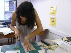 <i>Despite the innovations of on-demand publishing, some artists still like to bind books by hand at The Center for Book Arts.</i>