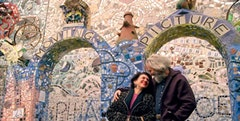 <i>Julia and Isaiah Zagar along the South Street Corridor in Philadelphia. Photo courtesy: Herzliya Films.</i>