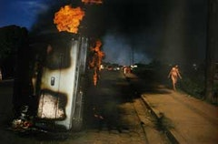 Car of a Somoza informer burning in Managua from Nicaragua. © Susan Meiselas—Magnum Photos.