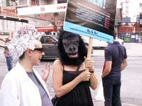 A Brainstormer and Guerrilla Girl preparing to protest Chelsea.