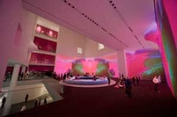Installation view of Pipilotti Rist's Pour Your Body Out (7354 Cubic Meters) at The Museum of Modern Art, 2008. Multichannel video projection (color, sound), projector enclosures, circular seating element, carpet. Courtesy the artist, Luhring Augustine, New York, and Hauser and Wirth Z üich London. © 2008 Pipilotti Rist. Photo: © Frederick Charles, fcharles.com.