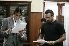 Amitabh Bachchan (left) being briefed by Apoorva Lakhia.