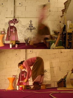 Koralie in her studio, painting her famous geisha on a canvas. Unlike most street artists, Koralie started her career by painting on canvas before switching to wall painting.