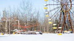 <i>A rusting amusement park near the Chernobyl plant. Photo by Stuck In Customs, flickr.com.</i>