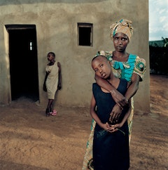 Valentine with her daughters, Amelie and Inez. By Jonathan Torgovnik, from the exhibition and book Intended Consequences: Rwandan Children Born of Rape (Aperture, 2009).