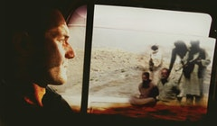 Christian Parenti traveling through Afghan countryside. Photo courtesy of Ian Olds. Composited with image of: Ajmal Naqshbandi (L) and Daniele Mastrogiacomo (R) at gunpoint in captivity.