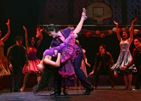 Karen Olivo as Anita and George Akram as Bernardo with The Company. ©2009, Joan Marcus