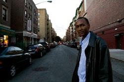 Bushara Dosa, president of the Darfur People's Association of New York, walks through the streets of Kensington. Photo by Kelly Kollar.