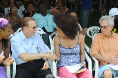Poet Staceyann Chin shaking hands with former Jamaican Prime Minister Edward Seaga at the Calabash International Literary Festival. Photo by Collin Reid.
