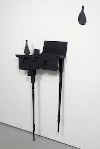 """Keiko Narahashi, """"Untitled (one black vase, split),"""" 2009, ceramic, wood, acrylic, 57 1/2"""" x 32 1/2"""" x 6 3/4"""" + 10 3/4"""" x 5"""" x 1/2""""."""