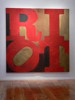 "Gran Fury, ""RIOT,"" 1988, oil on canvas; 8.5 x 8.5 feet. Installation detail at Tainted Love, La MaMa La Galleria, 2009. Courtesy The Lesbian, Gay, Bisexual & Transgender Community Center, NY, NY. Photo by Adriana Farmiga."