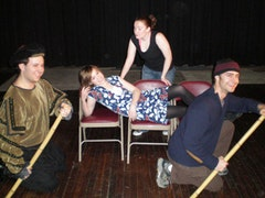 Shakespeare in ACTion (left to right: Joshua Levine, Natalie Kuhn recumbent, Kristy Dodson and Scott Barrow) during a performance in which the director was brought up during an audience participation section. Photo by Amy Sabin.