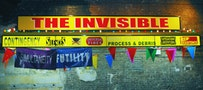 """Ester Partegàs, """"The Invisible"""" (2008). Aluminum and Plexiglas awning, bulbs, fluorescent lights, vinyl, banners, pennants. 20 ft × 14 ft × 2 ft 5 in. Commissioned by the Aldrich Museum, Ridgefield, CT. Courtesy of the artist and Foxy Production, New York. Installation at Brooklyn Academy of Music, Photo by Shervin Lainez."""