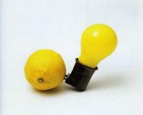 """Capri Battery� (Edition of 200). 3�× 4 3/8�× 2 3/8�. Light bulb, plug socket, lemon/wooden box (1985). Courtesy: Mary Boone Gallery, New York."
