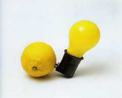 """Capri Battery� (Edition of 200). 3�× 4 3/8�× 2 3/8�. Light bulb, plug socket, lemon/wooden box (1985). Courtesy: Mary Boone Gallery, New York."
