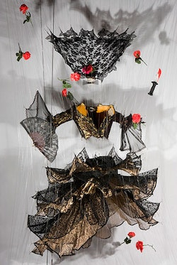 Carmen, (2009). Carmen costume from NYC Opera, plastic flowers and daggers, fishline and hardware.