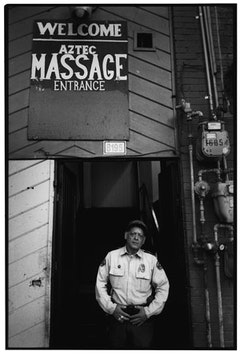 Security guard outside Aztec Massage.
