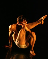 Larry Keigwin in <i>Mattress Suite.</i>  Photo by Steven Schreiber.