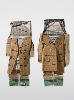 James Castle: Girls in tan coats with gable or landscape faces, n.d.; corrugated cardboard, tan paper from corrugated cardboard, cream paper, wrapping paper with silver printed design, thin gray cardboard faced with green paper, gray-green paper (from bag); cut, torn, folded, and wrapped; punched, stitched and tied with thin and thick white string; dark purple felt-tipped marker, wiped soot wash; 11 1/2 x 5 1/8 in.; The James Castle Collection, L.P. Courtesy of  J Crist Gallery, Boise, Idaho.