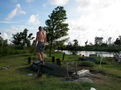 Herman Demoll's son stands on an island in the marsh, south of Venice. Photos by Vanessa Tolino.