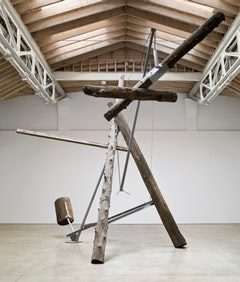 "Installation image from ""Mark di Suvero,"" Paula Cooper Gallery, New York, NY. Mark di Suvero, ""Nova Albion"" (1964-65). Steel and wood. 24 x 20 x 27 feet. ©Mark di Suvero. Courtesy Paula Cooper Gallery, New York. Photo: Ellen Page Wilson."