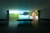 """Installation view of Projects 93: Dinh Q. Lê: Dinh Q. Lê in collaboration with Tran Quoc Hai, Le Van Danh, Phu-Nam Thuc Ha, and Tuan Andrew Nguyen. Still from """"The Farmers and The Helicopters."""" 2006. Three-channel video (color, sound), 15 min., and helicopter. The Museum of Modern Art, New York. Gift of the artist, Fund for the Twenty-First Century, and Committee on Media and Performance Art Funds. © 2010 Dinh Q. Lê. Courtesy the artist; P.P.O.W. Gallery, New York; Shoshana Wayne Gallery, Santa Monica; and Elizabeth Leach Gallery. Photo: Jason Mandella."""